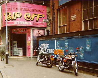 The Lyric Theatre stage door and Windmill Theatre entrance in June 1977. The CZ Motorcycle parked by The Lyric Theatre hoardings belonged to the late Sir Ralph Richardson who was also an avid BMW Motorcycle owner, he was appearing at the Lyric at the time, in 'The Kingfisher'. The other bike was mine. - Photo M.L. 1977.