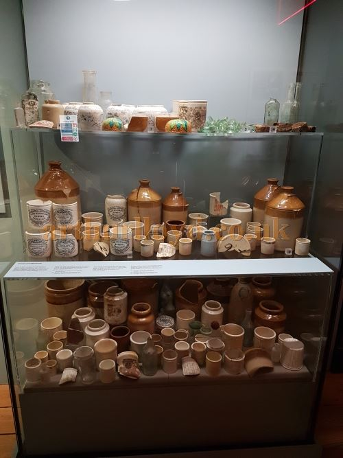 A hoard of old jars from the Astoria Theatre's previous incarnation as a Crosse & Blackwell pickle warehouse, discovered in bricked up cellars below the building during its demolition, as displayed in a temporary exhibition of Crossrail Archaeology at the Museum of Docklands in the spring of 2017 - Photo M.L.