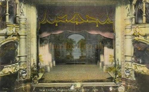 A colour postcard view of the auditorium of the Empire Theatre, Cardiff.