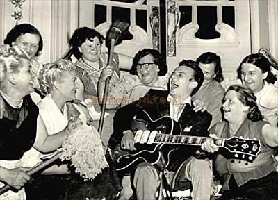 "Charlie Gracie, his guitar and the ""char-ladies"" backstage at the Hippodrome: August 1957."