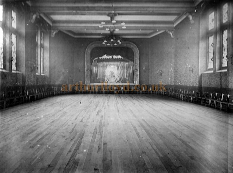 An early photograph of the interior and Stage of Munt's Hall - Courtesy The Munt Family Archive