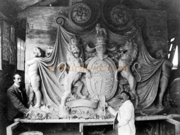 Charles Giddings (in the white coat) beside his creation for James Pulham and Son's Royal Coat of Arms for the Theatre Royal Drury Lane alterations of 1904 - Courtesy P. Hopper, a descendant of Charles Giddings - Kindly sent in by Claude Hitching of The Pulham Legacy.