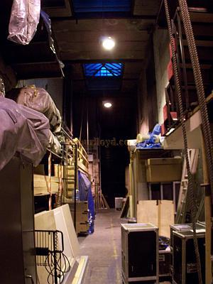 The 'Run' behind the stage at Drury Lane. This is used for temporary storage of equipment and for the cast and crew to get from one side of the stage to the other during performances.
