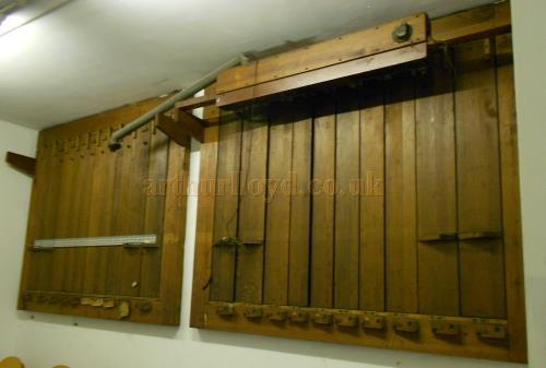 Two of the old wooden swell shutters for the Theatre's Organ which was in the two rooms behind the grille - Photo M. L.