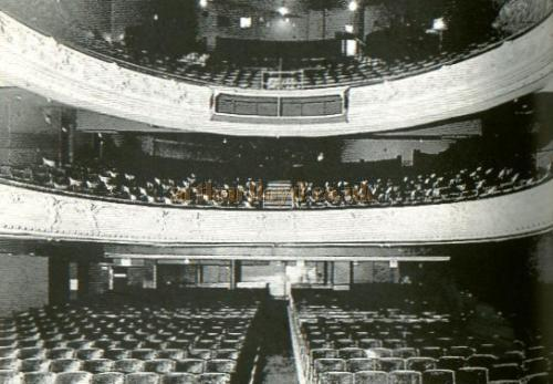 "An image of the auditorium of the Euston Theatre of Varieties during its time as the Regent Theatre, when it was about to return to Live entertainment with a pantomime in 1950. This photograph was displayed in the foyer of the Regent Theatre at that time. The metal casing in the centre of the upper circle was to house six ""Major Equipment"" pageant 1KW lanterns. - Courtesy Alan Chudley."