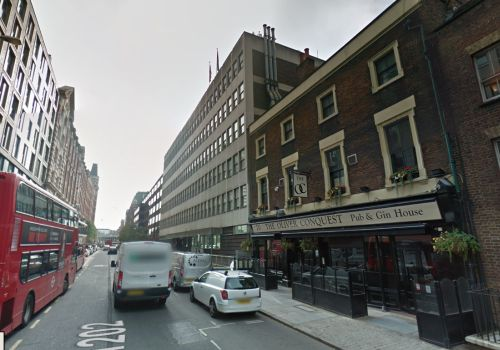 A Google StreetView Image of the Oliver Conquest Public House, formally the Garrick Public House, and next door, the site of the Garrick Theatre which was demolished for the construction of the Leman Street Police Station in 1891 - Click to Interact.