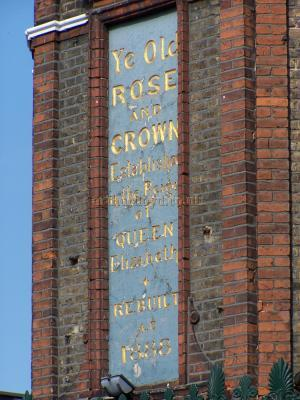 Sign on the corner of the Rose and Crown Pub reads - Ye Old Rose and Crown Established in the year of Queen Elizabeth Rebuilt 1888.