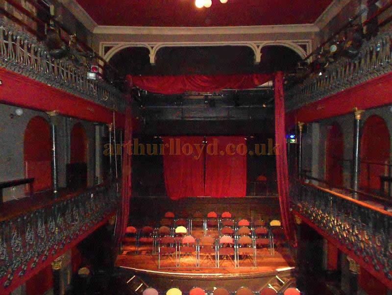 The Interior of the Hoxton Hall in September 2013 - Photo M. L. Here the stage is being used for seating, the reverse of how it was originally intended. The side and upper balconies shown here were added to the Hall in 1867.