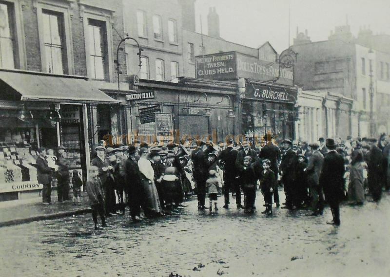 A Mission Meeting on Hoxton market in the early 1900s. A small sign indicates the entrance to Hoxton Hall - From one of the Hoxton Hall's current history displays - Courtesy The Hoxton Hall.