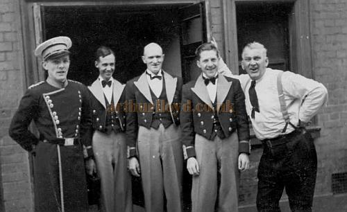 "The Floor Staff of the Kilburn Empire taken in September 1939. The person with the hat is probably Johnny Pennifer of Ladbrooke Grove who was often mentioned in conversation when I used to listen to stories about the Kilburn Empire which sadly I was too young to remember in detail. My father, James Williams, and he both started at the Kilburn Empire on the same day after leaving school together as they were neighbours in the same road, they also left the Kilburn Empire on the same day and went to the Tower Of London and joined up together to serve in the war. This is most probably the reason the pictures were taken. The person on the end in the shirt was the manager ""Bill"" I believe. He was also a Projectionist. The other people I have no knowledge of. - Picture and information Courtesy Peter Williams whose father worked at the Kilburn Empire from 1931 until he was called up for the war."