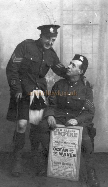 A WW1 era photograph of George Blackwell and another soldier holding a New Kilburn Empire poster for 'Oceans Away' - Courtesy Linda Phelan.