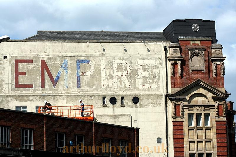 The side elevation of what remains of the Kingston Empire in August 2011. Note the Empire sign being cleaned on the side of the Theatre's Facade - Photo Courtesy Roger Fox.