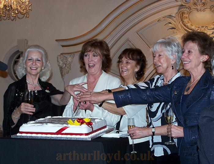 Introduced as the 'Tiller Girls' Jackie Simmonds, Rosalie Kirkman, Shirley Caught, June Vincent, & Rosemarie Russell cut the cake celebrating the London Palladium's 100th anniversary.