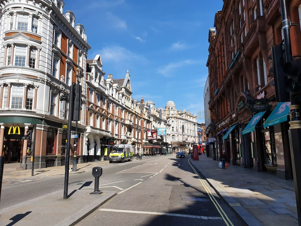 The Lyric, Apollo, Guilgud, and Sondheim Theatres on an almost deserted Shaftesbury Avenue, normally heaving with people and traffic - on March the 23rd 2020 during the Coronavirus Pandemic - Photo M.L.