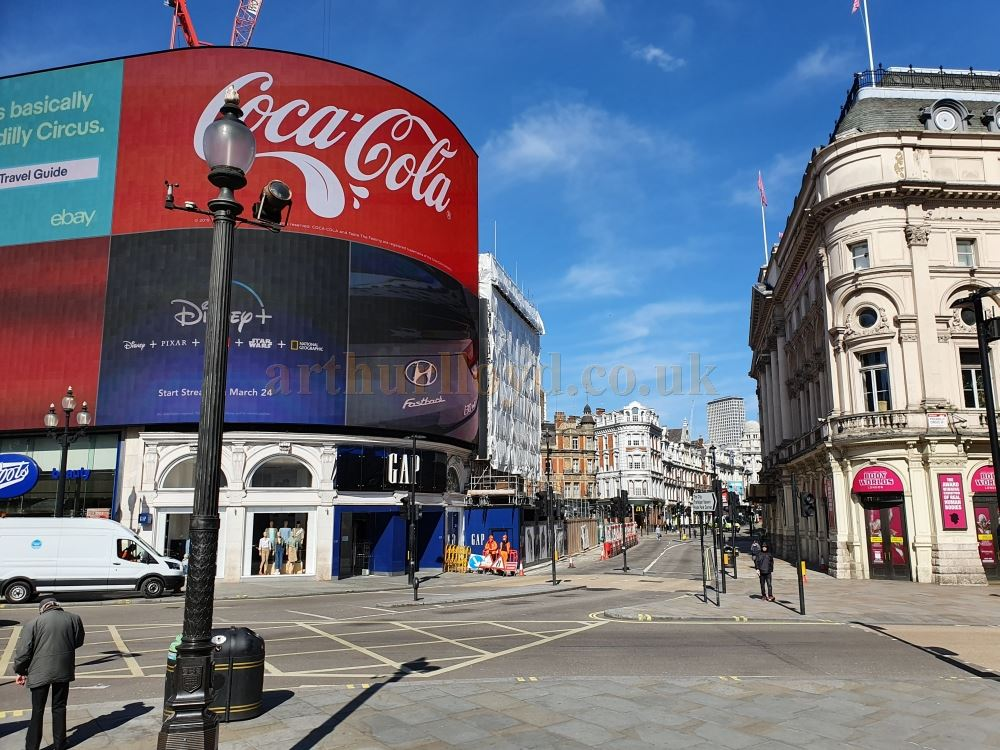 An almost deserted Piccadilly Circus and Shaftesbury Avenue, both normally heaving with people and traffic day and night - on March the 23rd 2020 during the Coronavirus Pandemic - Photo M.L.