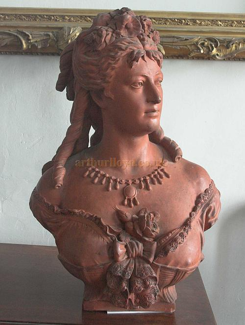 "A red Terra Cotta Bust of what is thought to be Lottie Collins, currently in the possession of David Bridgwater. The Bust is 27"" High by 18"" Wide across the shoulders, and David says it is his belief that it was originally made for exterior use, perhaps for the outside of a public house or Music Hall. - Photo Courtesy David Bridgwater."