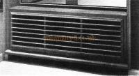 Standard ventilator and heating grille constructed of oak.