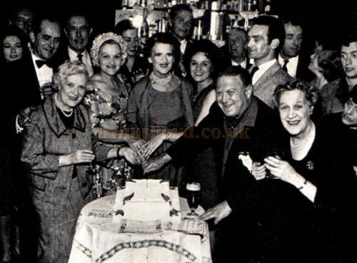 Zena Dare and the Cast of My Fair Lady cut the cake celebrating 100 years of the Theatre Royal, Nottingham in 1965.