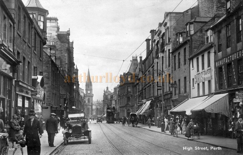 Perth High Street in the 1920s showing a Perth Theatre sign to right of the horse drawn cart - Courtesy Graeme Smith.