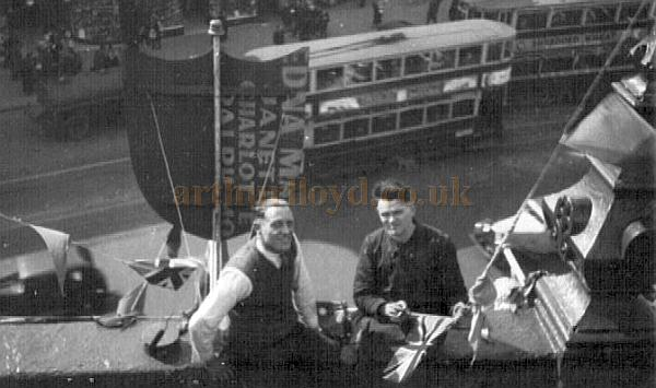Taking a break from decking out the Islington Empire with bunting and flags for the coronation of George VI in May 1937 - Courtesy Alan Towill whose father, Albert C. Towill, worked as a Maintenance Man at the Theatre at the time and is shown (right) in the photograph.