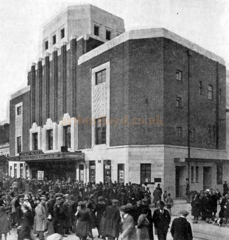 A crowd of people waiting to enter the Gaumont Palace Theatre, Plymouth in 1931 - From the Bioscope, 25th of November 1931.
