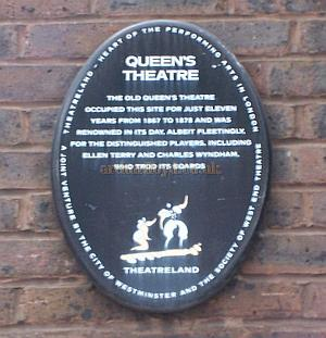A modern day plaque commemorating the site of the Queen's Theatre which is actually positioned on the wrong side of Endell Street and reads: 'Queen's Theatre - The old Queen's Theatre occupied this site for just eleven years from 1867 to 1878 and was renowned in its day, albeit fleetingly, for the distinguished players, including Ellen Terry and Charles Wyndham, who trod its boards.'