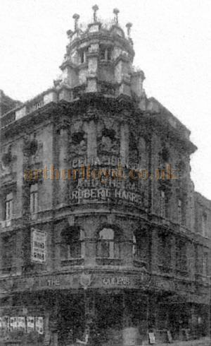 A photograph showing the original facade of the Queen's Theatre circa 1937 - From a 2003 Delfont Macintosh Press Handout.