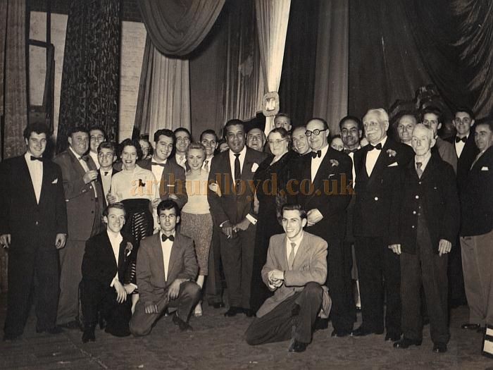 Members of the cast of a variety show pose for a photograph on stage at the Palace Theatre, Reading in August / September 1957 - Sparrow Harrison collection.