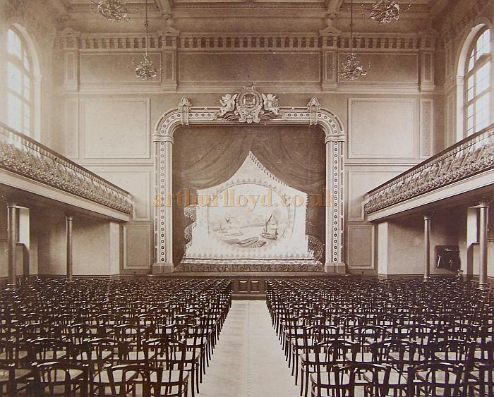 An early view of the interior and stage of the Rotherhithe Town Hall. The Curtain was painted by Mr. Bruce Smith and represented the Tower of London, as seen from the River Thames - Reproduced with the kind permission of the Southwark Local Studies Library.