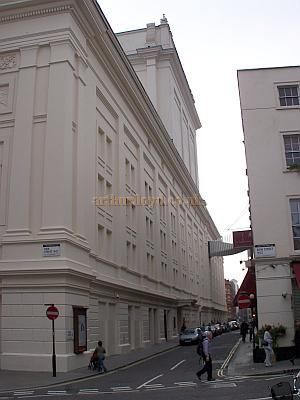 Floral Street elevation of the Royal Opera House, Covent Garden, showing the bridge over the street to more offices, and the stage door.