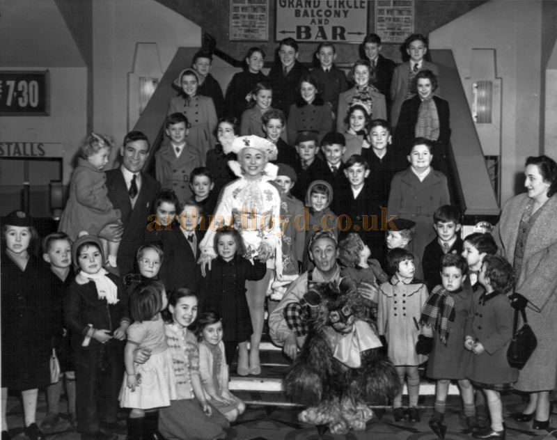 Members of the Cast and Audience of the Pantomime 'Dick Whittington' staged at the Garrick Theatre, Southport in the 1950s, pose for a publicity photograph in the Theatre's foyer - Courtesy Philip Hulm.