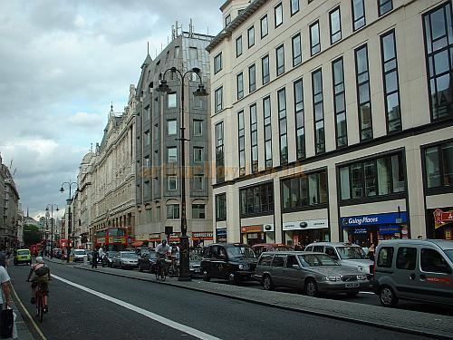 The Strand in 2003 - The new building on the right stands roughly on the site of the Tivoli Theatre, and also on the site of 71 The Strand where Horatio Lloyd's father Robert Lloyd worked as a Hatter, and where Horatio himself was born. Horatio Lloyd was also the father of Arthur Lloyd.