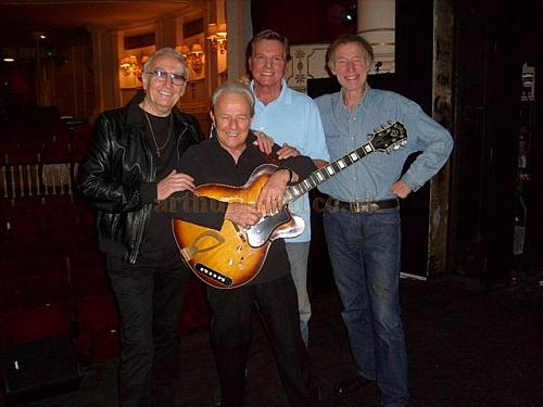 Charlie Gracie, Brian Poole of the Tremeloes, Jess Conrad, and Mike Sarne pose for a photograph on stage at the Theatre Royal, Windsor in November 2010 - Courtesy Charlie Gracie.