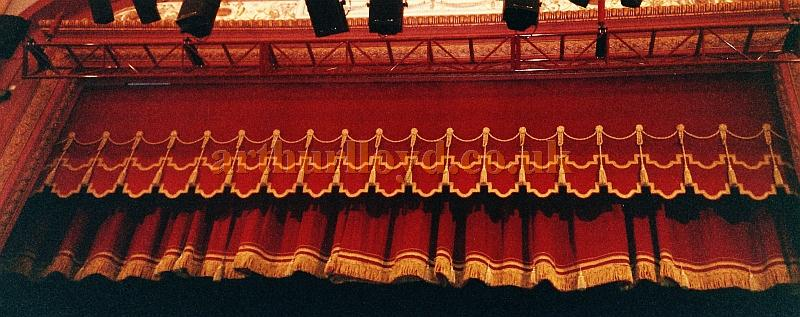 The proscenium and house tabs of the Grand Theatre, Wolverhampton in 2002 - Courtesy David Garratt