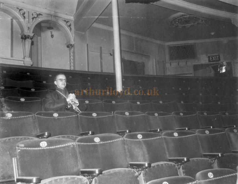 G. F. Humphreys, manager of the Ionic Cinema, Golder's Green, sitting in the Grand Circle of the Wood Green Empire in November 1968, some years after it had closed. - Courtesy Stephen Wischhusen.